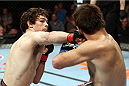 HALIFAX, NS - OCTOBER 4:  (L-R) Olivier Aubin-Mercier of Canada punches Jake Lindsey in their welterweight bout at the Scotiabank Centre on October 4, 2014 in Halifax, Nova Scotia, Canada. (Photo by Nick Laham/Zuffa LLC/Zuffa LLC via Getty Images)