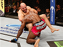 RIO DE JANEIRO, BRAZIL - OCTOBER 25:  (L-R) Glover Teixeira of Brazil attempts to secure a guillotine choke submission against Phil Davis in their light heavyweight bout during the UFC 179 event at Maracanazinho on October 25, 2014 in Rio de Janeiro, Brazil.  (Photo by Josh Hedges/Zuffa LLC/Zuffa LLC via Getty Images)