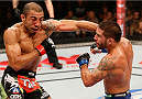 RIO DE JANEIRO, BRAZIL - OCTOBER 25:  (L-R) Jose Aldo of Brazil punches Chad Mendes in their featherweight championship bout during the UFC 179 event at Maracanazinho on October 25, 2014 in Rio de Janeiro, Brazil.  (Photo by Josh Hedges/Zuffa LLC/Zuffa LLC via Getty Images)
