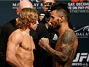 LAS VEGAS, NV - DECEMBER 05:  (L-R) Opponents Urijah Faber and Francisco Rivera face off during the UFC 181 weigh-in inside the Mandalay Bay Events Center on December 5, 2014 in Las Vegas, Nevada.  (Photo by Josh Hedges/Zuffa LLC/Zuffa LLC via Getty Images)