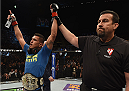 LAS VEGAS, NV - DECEMBER 06:  Anthony Pettis (left) has his hand raised by referee John McCarthy after his UFC lightweight championship bout during the UFC 181 event inside the Mandalay Bay Events Center on December 6, 2014 in Las Vegas, Nevada.  (Photo by Robert Laberge/Zuffa LLC/Zuffa LLC via Getty Images)