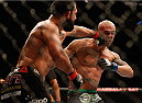 LAS VEGAS, NV - DECEMBER 06:  (L-R) Johny Hendricks punches Robbie Lawler in their UFC welterweight championship bout during the UFC 181 event inside the Mandalay Bay Events Center on December 6, 2014 in Las Vegas, Nevada.  (Photo by Josh Hedges/Zuffa LLC/Zuffa LLC via Getty Images)