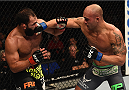 LAS VEGAS, NV - DECEMBER 06:  (R-L) Robbie Lawler punches Johny Hendricks in their UFC welterweight championship bout during the UFC 181 event inside the Mandalay Bay Events Center on December 6, 2014 in Las Vegas, Nevada.  (Photo by Robert Laberge/Zuffa LLC/Zuffa LLC via Getty Images)