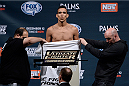 LAS VEGAS, NEVADA - DECEMBER 11:  UFC lightweight Charles Oliveira steps on the scale during The Ultimate Fighter Finale weigh-ins at the Palms Casino Resort on December 11, 2014 in Las Vegas, Nevada. (Photo by Jeff Bottari/Zuffa LLC/Zuffa LLC via Getty Images)
