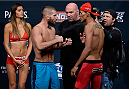LAS VEGAS, NEVADA - DECEMBER 11:  (L-R) Jeremy Stephens and Charles Oliveira face off during The Ultimate Fighter Finale weigh-ins at the Palms Casino Resort on December 11, 2014 in Las Vegas, Nevada. (Photo by Jeff Bottari/Zuffa LLC/Zuffa LLC via Getty Images)