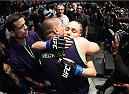 LAS VEGAS, NEVADA - DECEMBER 12: Rose Namajunas hugs her fianc Pat Barry before facing Carla Esparza in their strawweight championship fight during The Ultimate Fighter Finale event inside the Pearl concert theater at the Palms Casino Resort on December 12, 2014 in Las Vegas, Nevada. (Photo by Jeff Bottari/Zuffa LLC/Zuffa LLC via Getty Images)