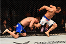 PHOENIX, AZ - DECEMBER 13:  (L-R) Stipe Miocic attempts a takedown against Junior Dos Santos of Brazil in their heavyweight fight during the UFC Fight Night event at the U.S. Airways Center on December 13, 2014 in Phoenix, Arizona.  (Photo by Josh Hedges/Zuffa LLC/Zuffa LLC via Getty Images)