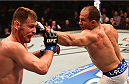 PHOENIX, AZ - DECEMBER 13:  (R-L) Junior Dos Santos of Brazil punches Stipe Miocic in their heavyweight fight during the UFC Fight Night event at the U.S. Airways Center on December 13, 2014 in Phoenix, Arizona.  (Photo by Josh Hedges/Zuffa LLC/Zuffa LLC via Getty Images)