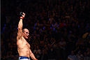PHOENIX, AZ - DECEMBER 13:  Junior dos Santos of Brazil celebrates after defeating Stipe Miocic by unanimous decision after their heavyweight fight during the UFC Fight Night event at the U.S. Airways Center on December 13, 2014 in Phoenix, Arizona.  (Photo by Josh Hedges/Zuffa LLC/Zuffa LLC via Getty Images)