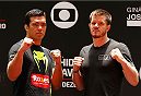 SAO PAULO, BRAZIL - DECEMBER 18:  (L-R) Opponents Lyoto Machida of Brazil and CB Dollaway of the United States pose for photos during an open training session for fans and media at Allianz Parque on December 18, 2014 in Sao Paulo, Brazil. (Photo by Josh Hedges/Zuffa LLC/Zuffa LLC via Getty Images)