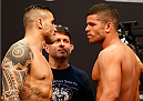 BARUERI, BRAZIL - DECEMBER 19:  (L-R) Opponents Daniel Sarafian of Brazil and Antonio dos Santos of Brazil face off during the UFC weigh-in event inside the Ginasio Jose Correa on December 19, 2014 in Barueri, Brazil. (Photo by Josh Hedges/Zuffa LLC/Zuffa LLC via Getty Images)