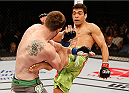 BARUERI, BRAZIL - DECEMBER 20:  (R-L) Lyoto Machida of Brazil kicks CB Dollaway of the United States in their middleweight fight during the UFC Fight Night event inside the Ginasio Jose Correa on December 20, 2014 in Barueri, Brazil. (Photo by Josh Hedges/Zuffa LLC/Zuffa LLC via Getty Images)