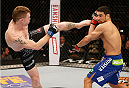 LAS VEGAS, NV - JANUARY 03:  (L-R) Paul Felder kicks Danny Castillo in their lightweight bout during the UFC 182 event at the MGM Grand Garden Arena on January 3, 2015 in Las Vegas, Nevada.  (Photo by Josh Hedges/Zuffa LLC/Zuffa LLC via Getty Images)