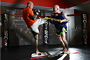 BOSTON, MA - JANUARY 15:  UFC lightweight Donald 'Cowboy' Cerrone (L) works out for the media and fans during the open workouts session at UFC Gym on January 15, 2015 in Boston, Massachusetts. (Photo by Jeff Bottari/Zuffa LLC/Zuffa LLC via Getty Images)