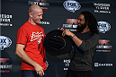 BOSTON, MA - JANUARY 16:  (L-R) UFC lightweights Donald 'Cowboy' Cerrone and Benson 'Smooth' Henderson interact with the media at Faneuil Hall on January 16, 2015 in Boston, Massachusetts. (Photo by Jeff Bottari/Zuffa LLC/Zuffa LLC via Getty Images)
