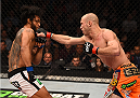 BOSTON, MA - JANUARY 18:  (R-L) Donald Cerrone punches Benson Henderson in their lightweight fight during the UFC Fight Night event at the TD Garden on January 18, 2015 in Boston, Massachusetts. (Photo by Jeff Bottari/Zuffa LLC/Zuffa LLC via Getty Images)
