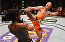 BOSTON, MA - JANUARY 18:  (R-L) Donald Cerrone kicks Benson Henderson in their lightweight fight during the UFC Fight Night event at the TD Garden on January 18, 2015 in Boston, Massachusetts. (Photo by Jeff Bottari/Zuffa LLC/Zuffa LLC via Getty Images)