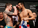 STOCKHOLM, SWEDEN - JANUARY 23:  (L-R) Opponents Andy Ogle of England and Makwan Amirkhani of Finland face off during the UFC Fight Night Weigh-ins at the Hovet Arena on January 23, 2015 in Stockholm, Sweden. (Photo by Josh Hedges/Zuffa LLC/Zuffa LLC via Getty Images)