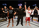 STOCKHOLM, SWEDEN - JANUARY 24:  Albert Tumenov (R) of Russia celebrates after his unanimous-decision victory over Nico Musoke of Sweden in their welterweight bout during the UFC Fight Night event at the Tele2 Arena on January 24, 2015 in Stockholm, Sweden. (Photo by Josh Hedges/Zuffa LLC/Zuffa LLC via Getty Images)