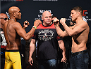 LAS VEGAS, NV - JANUARY 30:  (L-R)Former UFC middleweight champion Anderson Silva and Nick Diaz face off during the UFC 183 weigh-in at the MGM Grand Garden Arena on January 30, 2015 in Las Vegas, Nevada.  (Photo by Josh Hedges/Zuffa LLC/Zuffa LLC via Getty Images)