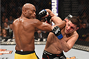 LAS VEGAS, NV - JANUARY 31:  (R-L)  Nick Diaz punches Anderson Silva in their middleweight bout during the UFC 183 event at the MGM Grand Garden Arena on January 31, 2015 in Las Vegas, Nevada.  (Photo by Josh Hedges/Zuffa LLC/Zuffa LLC via Getty Images) *** Local Caption *** Anderson Silva; Nick Diaz