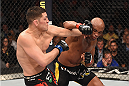 LAS VEGAS, NV - JANUARY 31:  (L-R) Nick Diaz punches Anderson Silva in their middleweight bout during the UFC 183 event at the MGM Grand Garden Arena on January 31, 2015 in Las Vegas, Nevada.  (Photo by Josh Hedges/Zuffa LLC/Zuffa LLC via Getty Images) *** Local Caption *** Anderson Silva; Nick Diaz