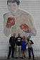 LAS VEGAS, NEVADA - JANUARY 28: From L-R - Forrest Griffin, Carlos Condit, Paige VanZant and Demetrious Johnson pose in front of the Muhammad Ali drawing at the famous Johnny Tocco boxing gym. (Photo by Brandon Magnus/Zuffa LLC/Zuffa LLC)