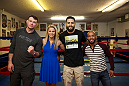 LAS VEGAS, NEVADA - JANUARY 28:  From L-R - Forrest Griffin, Paige VanZant, Carlos Condit, and Demetrious Johnson pose by the ring at the famous Johnny Tocco's boxing gym. (Photo by Brandon Magnus/Zuffa LLC/Zuffa LLC)