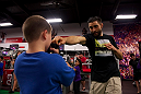 LAS VEGAS, NEVADA - JANUARY 28: UFC welterweight Carlos Condit shows off his reach against a willing participant at the UFC Gym in Green Valley. (Photo by Brandon Magnus/Zuffa LLC/Zuffa LLC).