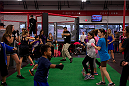 LAS VEGAS, NEVADA - JANUARY 28: UFC welterweight Carlos Condit teaches some moves to children at the UFC Gym in Green Valley. (Photo by Brandon Magnus/Zuffa LLC/Zuffa LLC).