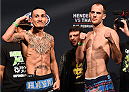 BROOMFIELD, CO - FEBRUARY 13: (L-R) Opponents Max Holloway and Cole Miller pose for photos during the UFC weigh-in at the 1stBank Center on February 13, 2015 in Broomfield, Colorado. (Photo by Josh Hedges/Zuffa LLC/Zuffa LLC via Getty Images)
