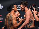 BROOMFIELD, CO - FEBRUARY 13: (L-R) Opponents Benson Henderson and Brandon Thatch shake hands during the UFC weigh-in at the 1stBank Center on February 13, 2015 in Broomfield, Colorado. (Photo by Josh Hedges/Zuffa LLC/Zuffa LLC via Getty Images)