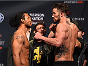 BROOMFIELD, CO - FEBRUARY 13: (L-R) Opponents Benson Henderson and Brandon Thatch face off during the UFC weigh-in at the 1stBank Center on February 13, 2015 in Broomfield, Colorado. (Photo by Josh Hedges/Zuffa LLC/Zuffa LLC via Getty Images)