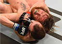 BROOMFIELD, CO - FEBRUARY 14:  Zach Makovsky (bottom) controls the body of Timothy Elliott in their flyweight fight during the UFC Fight Night event inside 1stBank Center on February 14, 2015 in Broomfield, Colorado. (Photo by Josh Hedges/Zuffa LLC/Zuffa LLC via Getty Images)