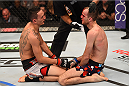 BROOMFIELD, CO - FEBRUARY 14:  (L-R) Max Holloway and Cole Miller kneel in the center of the Octagon after their featherweight fight during the UFC Fight Night event inside 1stBank Center on February 14, 2015 in Broomfield, Colorado. (Photo by Josh Hedges/Zuffa LLC/Zuffa LLC via Getty Images)