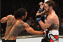BROOMFIELD, CO - FEBRUARY 14:  (L-R) Benson Henderson lands a punch to the body of Brandon Thatch in their welterweight fight during the UFC Fight Night event inside 1stBank Center on February 14, 2015 in Broomfield, Colorado. (Photo by Josh Hedges/Zuffa LLC/Zuffa LLC via Getty Images)