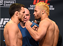 LOS ANGELES, CA - FEBRUARY 27:  (L-R) Opponents Jake Ellenberger and Josh Koscheck face off during the UFC 184 weigh-in at the Event Deck and LA Live on February 27, 2015 in Los Angeles, California. (Photo by Josh Hedges/Zuffa LLC/Zuffa LLC via Getty Images)