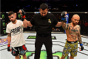 "LOS ANGELES, CA - FEBRUARY 28:  (L) Roman Salazar and Norifumi ""Kid"" Yamamoto's bantamweight bout is declared a no contest during the UFC 184 event at Staples Center on February 28, 2015 in Los Angeles, California.  (Photo by Josh Hedges/Zuffa LLC/Zuffa LLC via Getty Images)"