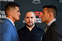 DALLAS, TX - MARCH 12:  (L-R) UFC lightweight champion Anthony Pettis and oponent Rafael dos Anjos of Brazil face off during the UFC 185 Ultimate Media Day at the American Airlines Center on March 12, 2015 in Dallas, Texas. (Photo by Josh Hedges/Zuffa LLC/Zuffa LLC via Getty Images)