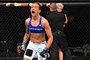 DALLAS, TX - MARCH 14:  (L-R) Germaine de Randamie celebrates after defeating Larissa Pacheco in their women's bantamweight bout during the UFC 185 event at the American Airlines Center on March 14, 2015 in Dallas, Texas. (Photo by Josh Hedges/Zuffa LLC/Zuffa LLC via Getty Images)