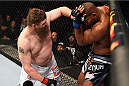 DALLAS, TX - MARCH 14:  (L-R) Roy Nelson punches Alistair Overeem in their heavyweight bout during the UFC 185 event at the American Airlines Center on March 14, 2015 in Dallas, Texas. (Photo by Josh Hedges/Zuffa LLC/Zuffa LLC via Getty Images)