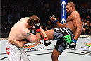 DALLAS, TX - MARCH 14:  (R-L) Alistair Overeem kicks the body of Roy Nelson in their heavyweight bout during the UFC 185 event at the American Airlines Center on March 14, 2015 in Dallas, Texas. (Photo by Josh Hedges/Zuffa LLC/Zuffa LLC via Getty Images)