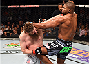 DALLAS, TX - MARCH 14:  (R-L) Alistair Overeem lands a knee to the body of Roy Nelson in their heavyweight bout during the UFC 185 event at the American Airlines Center on March 14, 2015 in Dallas, Texas. (Photo by Josh Hedges/Zuffa LLC/Zuffa LLC via Getty Images)