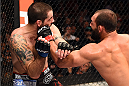 DALLAS, TX - MARCH 14:  (R-L) Johny Hendricks punches Matt Brown in their welterweight bout during the UFC 185 event at the American Airlines Center on March 14, 2015 in Dallas, Texas. (Photo by Josh Hedges/Zuffa LLC/Zuffa LLC via Getty Images)
