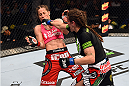 FAIRFAX, VA - APRIL 04:   (R-L) Lauren Murphy punches Liz Carmouche in their women's bantamweight fight during the UFC Fight Night event at the Patriot Center on April 4, 2015 in Fairfax, Virginia. (Photo by Josh Hedges/Zuffa LLC/Zuffa LLC via Getty Images)