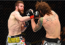 FAIRFAX, VA - APRIL 04:  (L-R) Mitch Clarke punches Michael Chiesa in their lightweight fight during the UFC Fight Night event at the Patriot Center on April 4, 2015 in Fairfax, Virginia. (Photo by Josh Hedges/Zuffa LLC/Zuffa LLC via Getty Images)