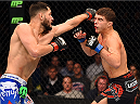 FAIRFAX, VA - APRIL 04:  (L-R) Jorge Masvidal punches Al Iaquinta in their lightweight fight during the UFC Fight Night event at the Patriot Center on April 4, 2015 in Fairfax, Virginia. (Photo by Josh Hedges/Zuffa LLC/Zuffa LLC via Getty Images)