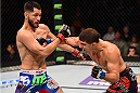 FAIRFAX, VA - APRIL 04:  (R-L) Al Iaquinta punches Jorge Masvidal in their lightweight fight during the UFC Fight Night event at the Patriot Center on April 4, 2015 in Fairfax, Virginia. (Photo by Josh Hedges/Zuffa LLC/Zuffa LLC via Getty Images)