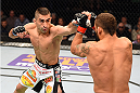 FAIRFAX, VA - APRIL 04:  (L-R) Ricardo Lamas throw a punch against Chad Mendes in their featherweight fight during the UFC Fight Night event at the Patriot Center on April 4, 2015 in Fairfax, Virginia. (Photo by Josh Hedges/Zuffa LLC/Zuffa LLC via Getty Images)