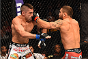 FAIRFAX, VA - APRIL 04:  (EDITOR'S NOTE: Alternative crop for #468617858) (R-L) Chad Mendes punches Ricardo Lamas in their featherweight fight during the UFC Fight Night event at the Patriot Center on April 4, 2015 in Fairfax, Virginia. (Photo by Josh Hedges/Zuffa LLC/Zuffa LLC via Getty Images)